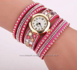 Роскошные часы-браслет с каскадом камней