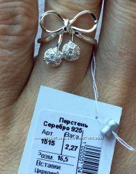Серебряное кольцо. В виде бантика. Оригинально.