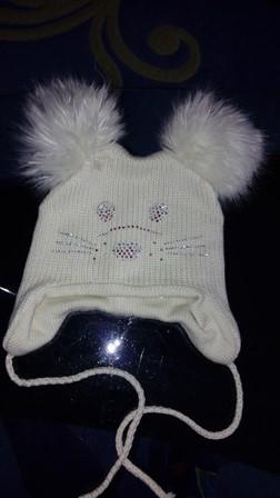 красивая теплая шапка фирмы TUTU