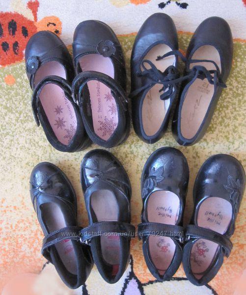 Черные туфли Clarks для первоклашки