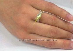 Кольцо с крупным бриллиантом и россыпью