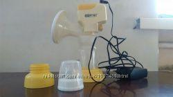 Электрический молокоотсос dr frei