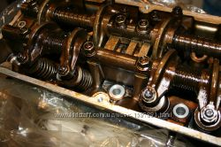 Головка блока двигателя с распредвалом, клапанами, маховиком рычагами