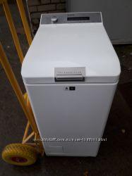 Стиральная машина AEG Protex вертикальная 40см