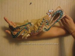 Продам комплект из лифа, пояса и 3 юбок для восточного танца